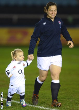 England harlot Emma Croker walks onto a margin with daughter Lucy forward of this year's Six Nations compare with Wales