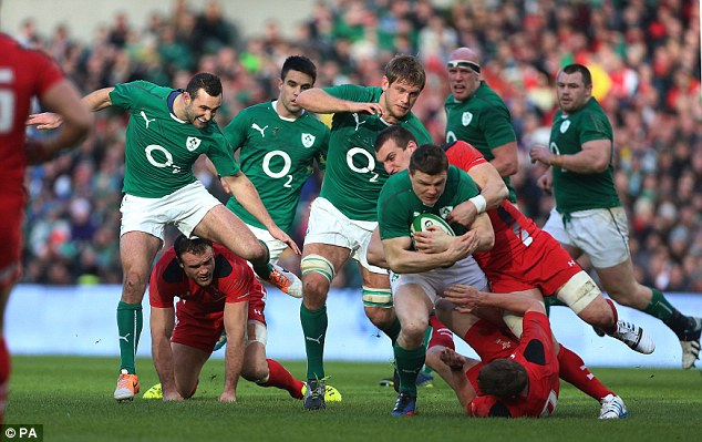 Crunch: Ireland centre Brian O'Driscoll (centre right) is tackled by Wales captain Sam Warburton