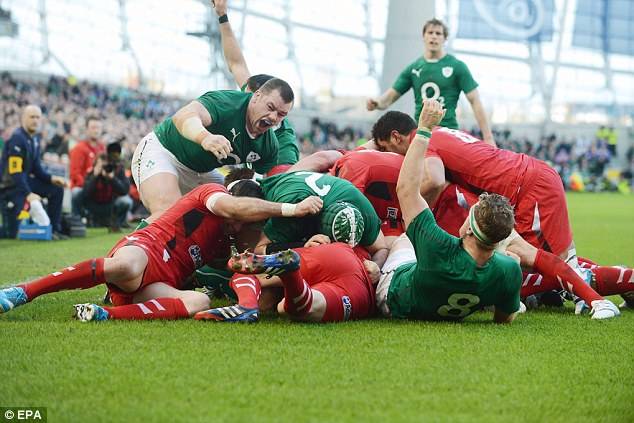 Try time: Ireland applaud after Chris Henry (hidden) touches down after a expostulate from a lineout