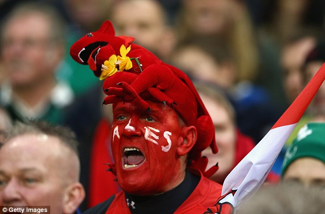 Red faced: A Wales believer shouts support to his group though was eventually left disappointed