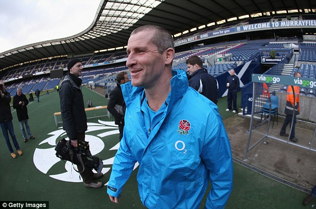 Man during a top: England manager Stuart Lancaster walks out onto a representation during Murrayfield