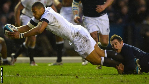 Luther Burrell dives over to measure England's opening try during Murrayfield